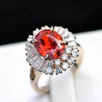 a ring set with a pigeon's egg ruby